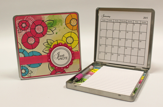 note pad and tins